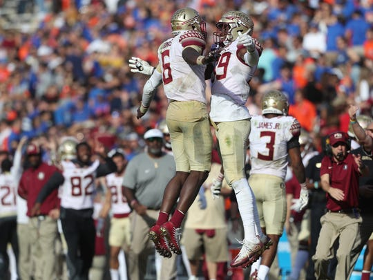 FSU's Matthew Thomas, left, celebrates with Brian Burns