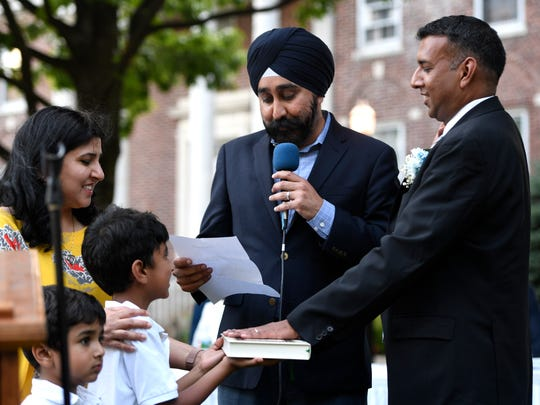 Hoboken Mayor Ravinder Bhalla swears in Teaneck Mayor Mohammed Hameeduddin, with his wife Faiza and sons Zain, 5, and Ahsan, 7, during the council reorganization meeting on Monday, July 2, 2018.
