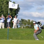 James Nicholas chips onto the 15th green at Winged Foot West during the championship match of the Anderson Memorial Four-Ball Invitational.
