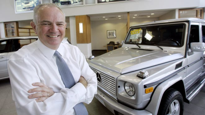 Mike Jackson, CEO of AutoNation, poses at Mercedes-Benz of Fort Lauderdale. AutoNation has halted sales of vehicles under recall