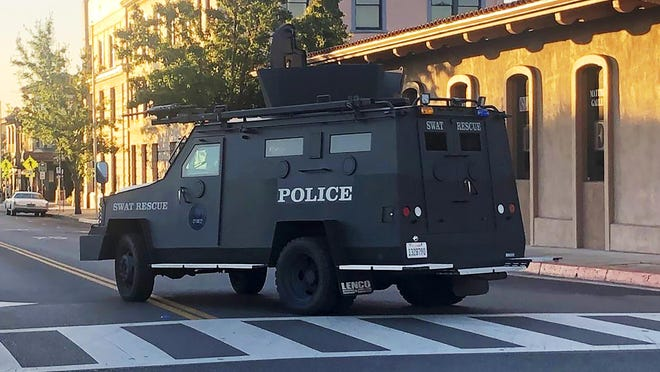 An armored vehicle patrols the streets of Paso Robles in California's Central Coast region after a sheriff's deputy was wounded after someone opened fire on a police station early Wednesday. The motive was not known.