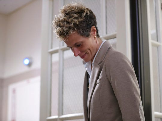 Accuser Andrea Constand leaves after the first day