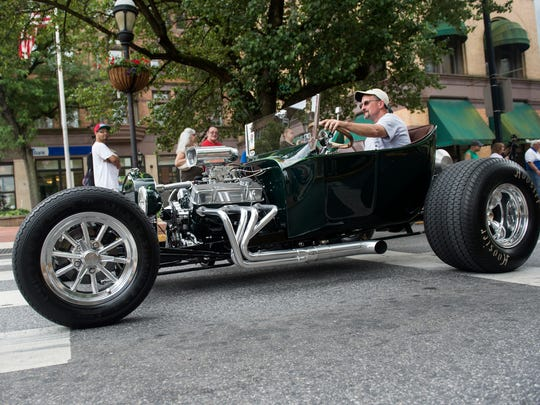 Street rod owners parade down Market street during the 45th annual Street Rod Nationals East event, Friday, June 1, 2018.