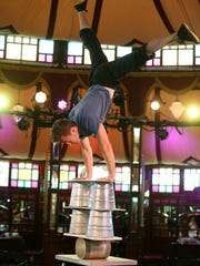 Jan Damm, of Cirque du Fringe works on his balancing act during a rehearsal for the Miracle Cure show in the Spiegeltent, for the Rochester Fringe Festival (2016 file photo).