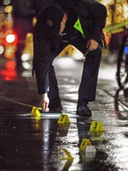 Burlington police investigate the scene of a fatal shooting on Dec. 27, 2015, on lower Church Street near Zen Lounge. Chavis Murphy, 26, of Burlington is accused of first-degree murder following the shooting death of Obafemi Adedapo, 28, of New York City.