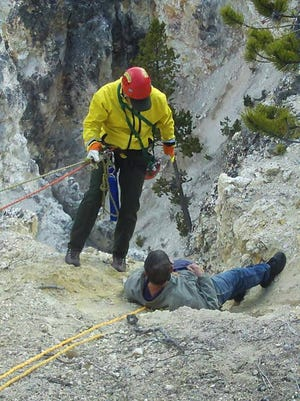 A park rescue team pulls the man back to the rim using ropes and pulleys.