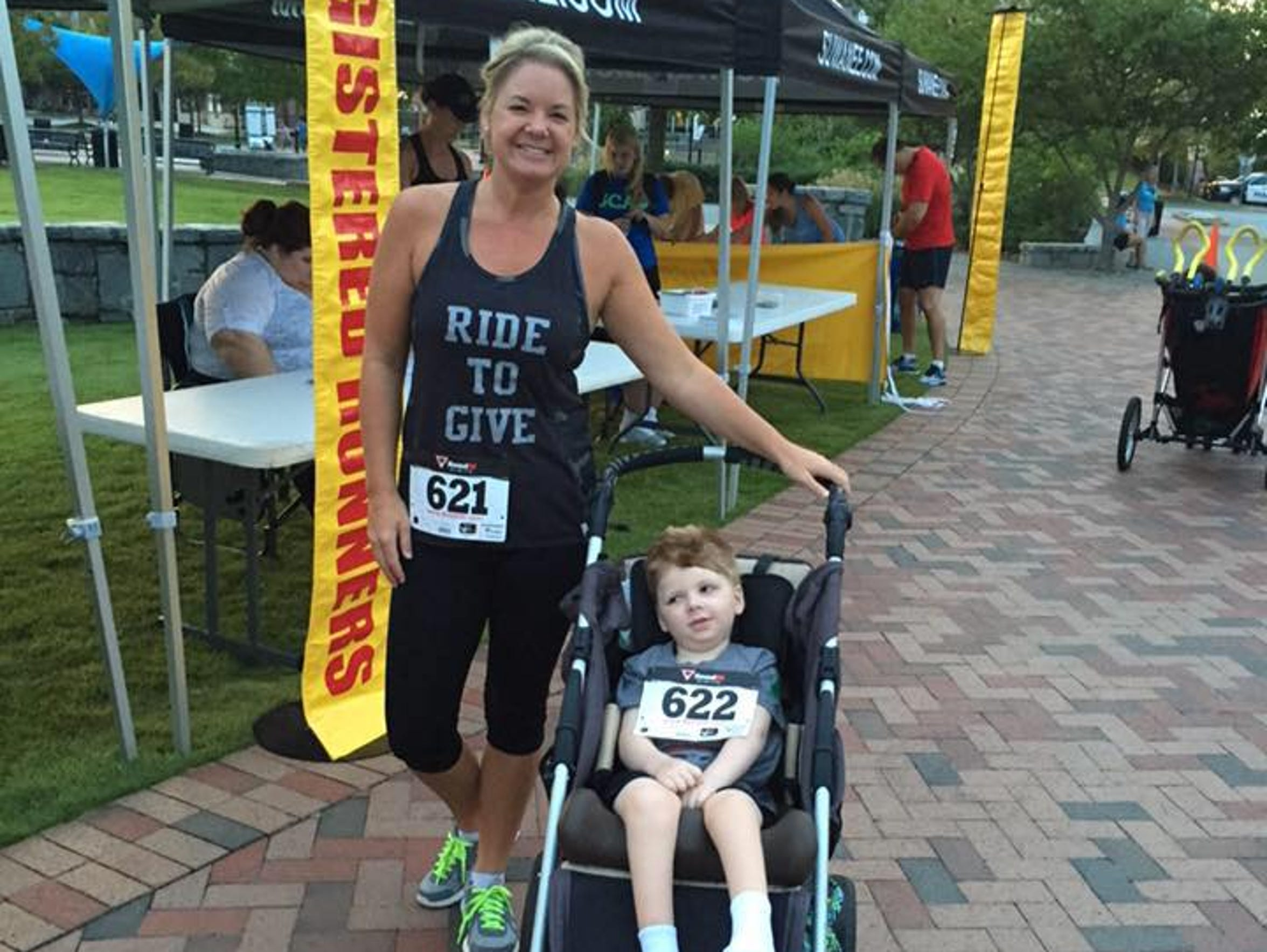Stacy and Tripp, at a Ride to Give event.