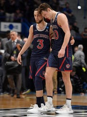 St. Mary's Jordan Ford, left, and Tanner Krebs walk off the court together at the end of a first round men's college basketball game against Villanova in the NCAA tournament, Thursday, March 21, 2019, in Hartford, Conn. (AP Photo/Jessica Hill)