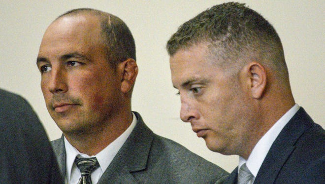In this Aug. 18, 2015 photo, former Albuquerque Police detective Keith Sandy, left, and Officer Dominique Perez speak with attorneys during a preliminary hearing in Albuquerque, N.M. The two Albuquerque police officers who opened fire on a homeless man in a fatal shooting that led to protests and national outcry two years ago will stand trial for murder this month, with jury selection in the case set to begin Monday, Sept. 12.
