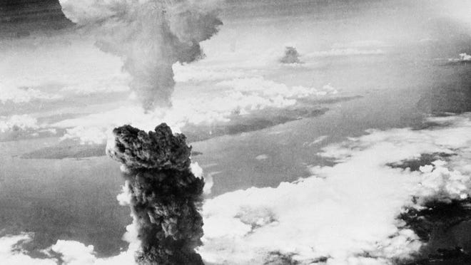 In this Aug. 9, 1945, file photo, a giant column of smoke rises after the second atomic bomb ever used in warfare explodes over the Japanese port town of Nagasaki. Japan surrendered on Aug. 15, ending World War II and its nearly a half-century aggression toward Asian neighbors.
