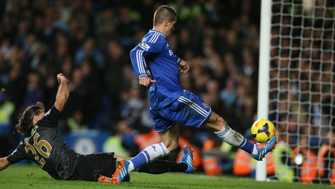Chelsea's Fernando Torres, right, shots and scores the winning goal during the English Premier League soccer match between Chelsea and Manchester City at Stamford Bridge stadium in London.