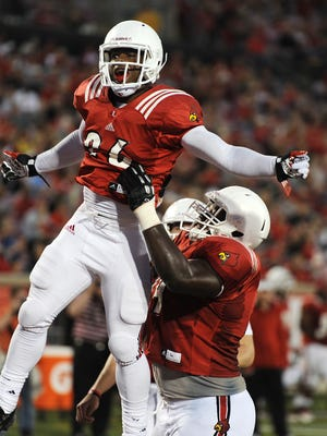 Louisville's Michael Dyer was hoisted by teammate DeAngelo Brown after Dyer scored a touchdown during the Cardinals' spring game.