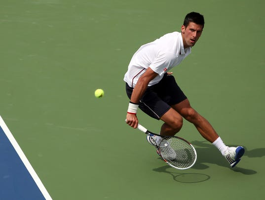 2014-8-1-novak-djokovic-running-open