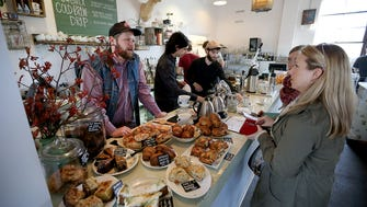 Customers place their orders at Milktooth's pastry and coffee counter. Milktooth is the first restaurant of chef/owner Jonathan Brooks and his wife Ashley located at 534 Virginia Ave.