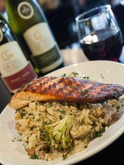 Wild grilled salmon over roasted vegetable parmigiano risotto is among the entrees available at Nico & Vali during the 4th Annual Plymouth Restaurant Week.