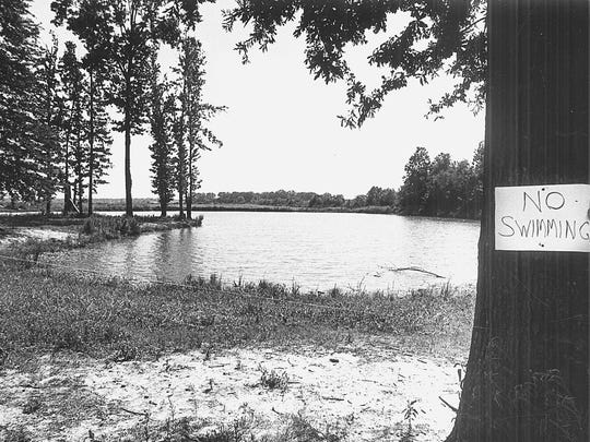 The News-Star File Photo - June 29, 1983. A sign hangs on a tree at the pond where Joe Delaney and two boys he was trying to save drowned.