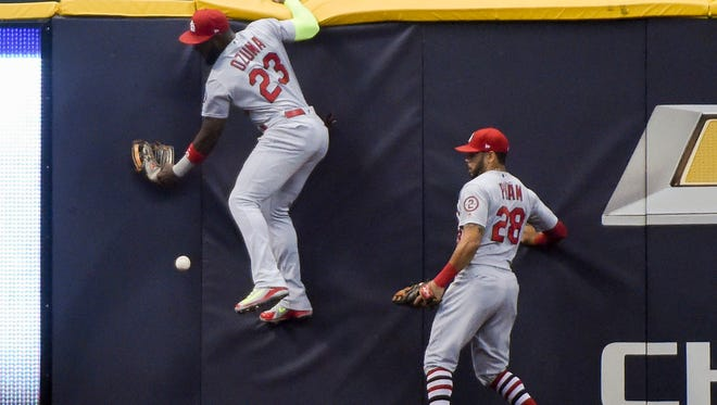 Cardinals leftfielder Marcell Ozuna (23) misplays a ball hit by the Brewers' Jesus Aguilar that goes for a two-run double in the first inning on Thursday night at Miller Park.