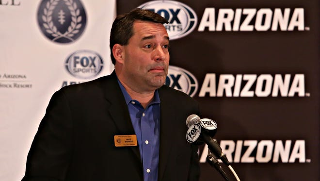 Mike Muraco, executive director of the Valley of the Sun chapter of the National Football Foundation, addresses a group during National Letter of Intent signing day at the Hilton Scottsdale Resort on Feb., 4, 2015