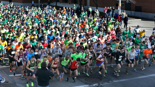 Nearly 1,700 runners took part in the five-mile course of the 18th annual Johnny's Running of the Green on Saturday.