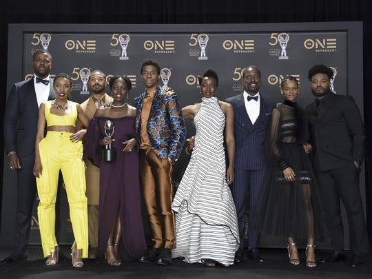 "The cast of ""Black Panther"" pose in the press room with the award for outstanding motion picture at the 50th annual NAACP Image Awards on Saturday, March 30, 2019, at the Dolby Theatre in Los Angeles. ""Black Panther"" also won best actor (Chadwick Boseman), supporting actor (Michael B. Jordan) and directing  (Ryan Coogler)."