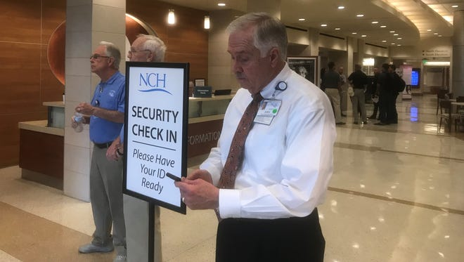 John Griffith, director of security for the NCH Healthcare System, watches over the first day of new security measures at NCH Baker Hospital Downtown.