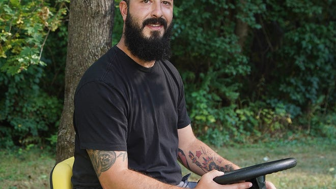 Jared Loura, at home in Dighton on Wednesday, Aug. 19, 2020, said he has turned his life around since seeking treatment for addiction. Taunton Gazette | Mike Gay