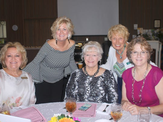 New members (seated) Ruth Lee DeVaughn, Deb Reed and Bonnie Watson are welcomed by Sharon Cook and Jackie Hays.