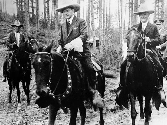 U.S. President Calvin Coolidge is on horseback to attend the dedication ceremony of the Mount Rushmore Memorial in South Dakota,  Aug. 15, 1927.  (AP Photo)