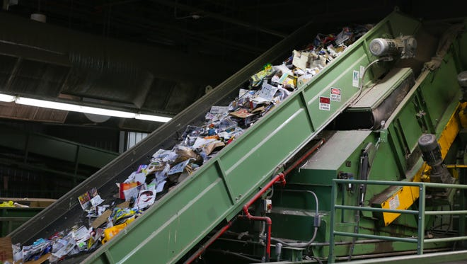 620 tons of recycled goods get processed by the City of Phoenix's recycling facilities every day. Goods get pushed up a belt at the city's 27th Avenue processing facility in Phoenix, Arizona on June 21, 2018.