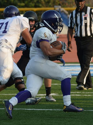 CLU running back Chris Beeson carries the ball in a scrimmage against Moorpark College on Aug. 25.