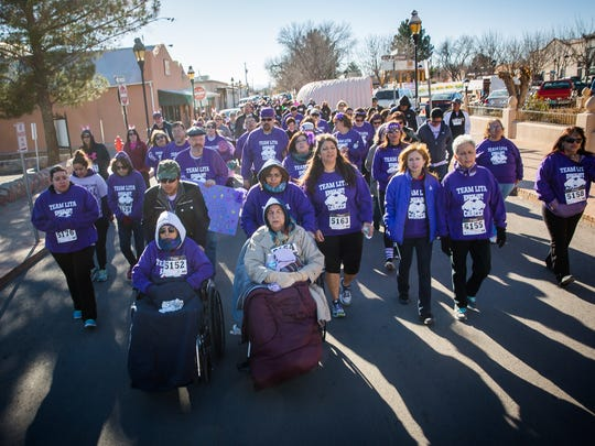 """Members of """"Team Lita"""" walk during Cancer Aid Resource & Education's Race for Care event in Mesilla. Sonja Portillo, who organized the team on behalf of her sister Lita Luan, who is battling pancreatic cancer, says up to 69 people participated in the team to raise money for CARE."""