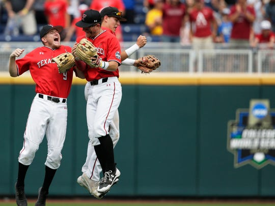 Texas Tech outfielders Dylan Neuse (9), Max Marusak and Kurt Wilson, rear right, celebrate their win over Arkansas in an NCAA College World Series baseball game in Omaha, Neb., Monday, June 17, 2019. (AP Photo/Nati Harnik)