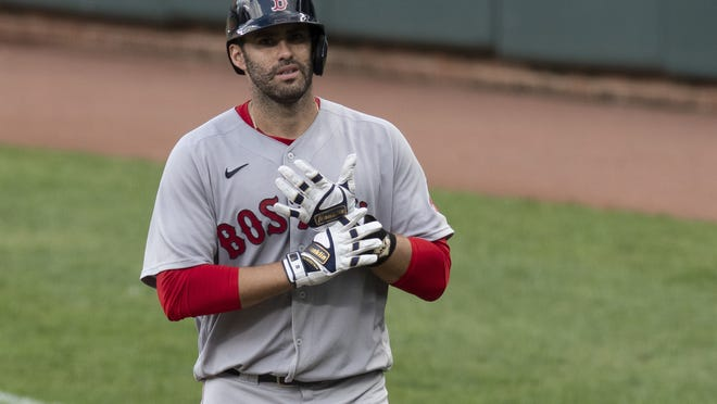 Boston Red Sox's J.D. Martinez stands at first base during a baseball game against the Baltimore Orioles, Sunday, Aug. 23, 2020, in Baltimore.