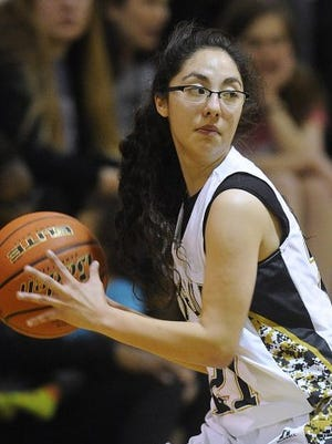 Abilene High's Elyssia Esquivel (21) passes the ball to a teammate during the first quarter of the Lady Eagles' 54-37 win on Friday, Jan. 8, 2015, at Abilene High School.