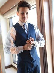 Jaren Guerrero, 2015 Mister Global Guam, accessorizes with a classic stainless steel timepiece at the Dusit Thani Guam Resort on Oct. 14.