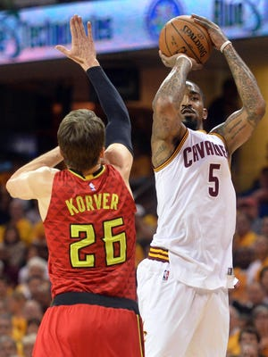 Cleveland Cavaliers guard J.R. Smith (5) shoots a three-pointer over Atlanta Hawks guard Kyle Korver (26) during the first quarter in game two of the second round of the NBA Playoffs at Quicken Loans Arena.