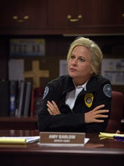 Deputy Chief Amy Barlow at her desk at the Jackson
