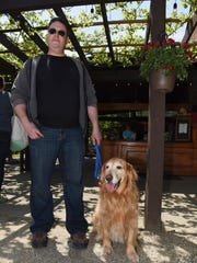 Max Feil of Bayside stands with his dog Monty at Woof