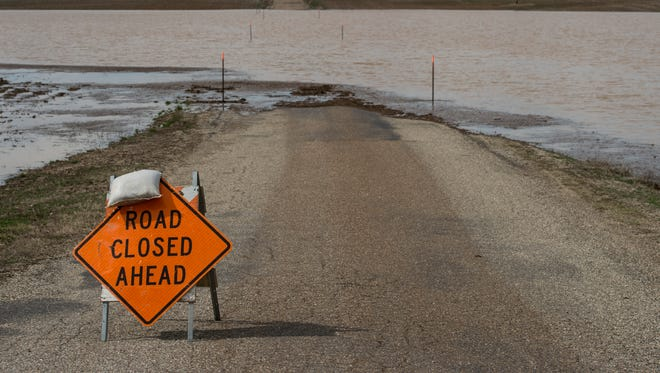 A road of highway 69 near Hovey Lake is closed do to flooding in Point Twp. on Sunday, Feb. 25, 2018.