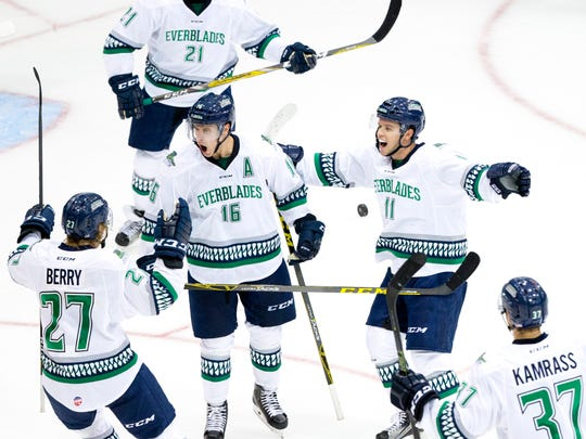 Everblades' players celebrate with Mike Aviani (16) after Aviani scored the game-tying goal with 59 seconds left in the third period of action at Germain Arena Friday, October 14, 2016 in Estero. The Everblades would score all of their three goals in the final three minutes of regulation defeating the Greenville Swamp Rabbits 3-2 in their first game of the season.