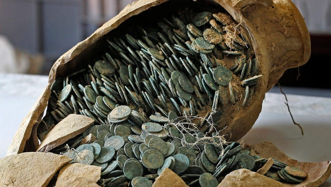 A picture made available on April 29, 2016, shows one of 19 Roman amphoras discovered in the town of Tomares, near Seville, containing around 600 kg of bronze and silver coins dating from the 4th century, in Seville, Spain.