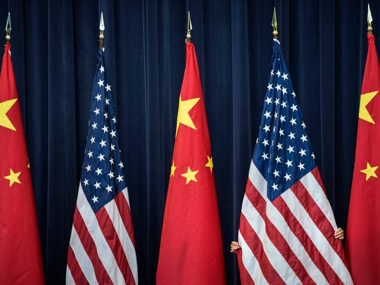 US and Chinese flags before the opening session of