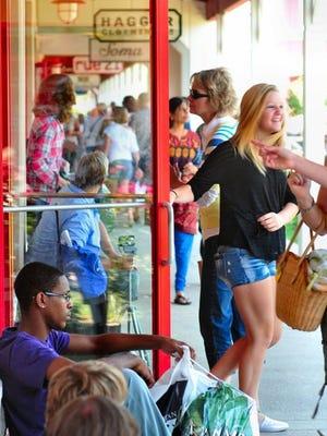 Shoppers exploring the Tanger Outlook Center in Jeffersonville.