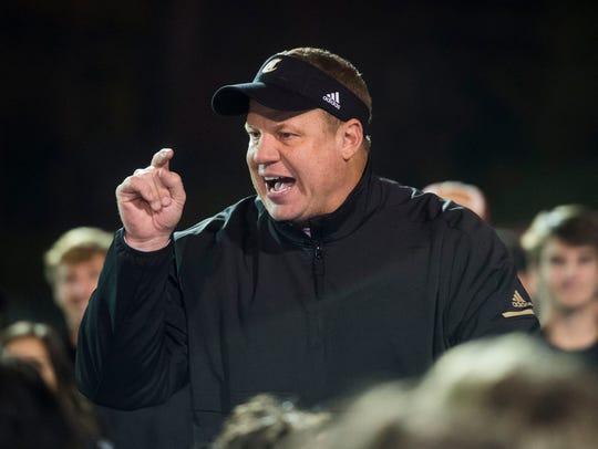 Catholic's head coach Steve Matthews speaks to his