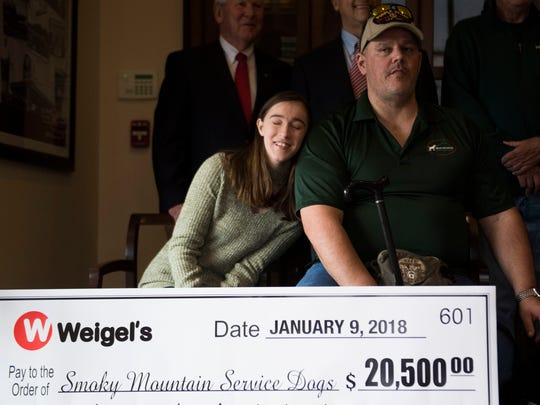 Olivia Belcher leans on her father, veteran Daniel
