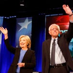 Democratic presidential candidates Hillary Clinton and Sen. Bernie Sanders, I-Vt,  stand together last month before the start of the NBC, YouTube Democratic presidential debate at the Gaillard Center in Charleston, S.C.  (AP Photo/Mic Smith)