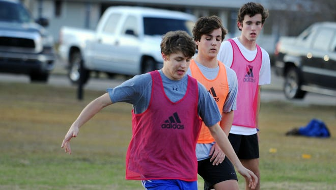 The Sacred Heart boys soccer team practices at Tatum Park Wednesday afternoon.