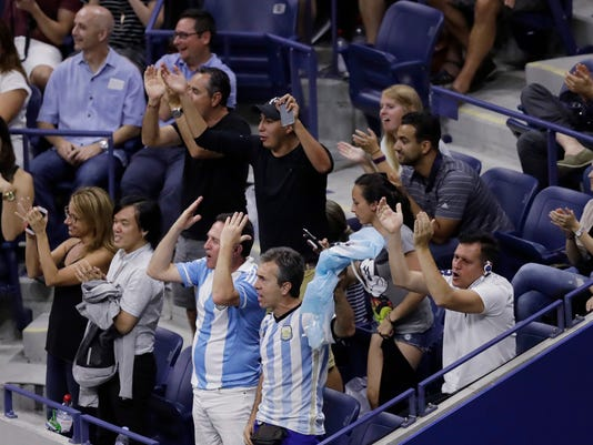 Fans applaud for Juan Martin del Potro, of Argentina, near the end of his loss to Stan Wawrinka, of Switzerland, during the quarterfinals at the U.S. Open tennis tournament, early Thursday, Sept. 8, 2016, in New York. Wawrinka won 7-6 (5), 4-6, 6-3, 6-2. (AP Photo/Charles Krupa)