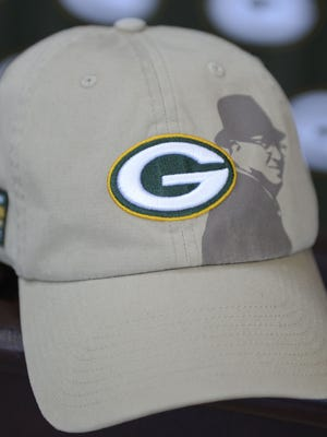The Green Bay Packers will sell hats to raise cancer awareness beginning in October.