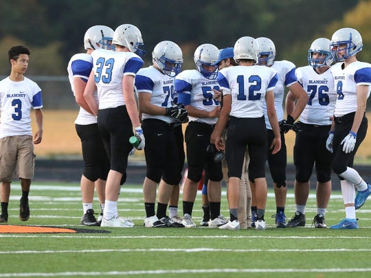 Members of the Blanchet team during a huddle on Friday, Sept. 18, 2015, in Scio, Ore.